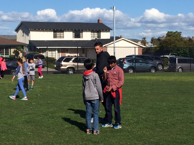 playworks coach and 5th grade students