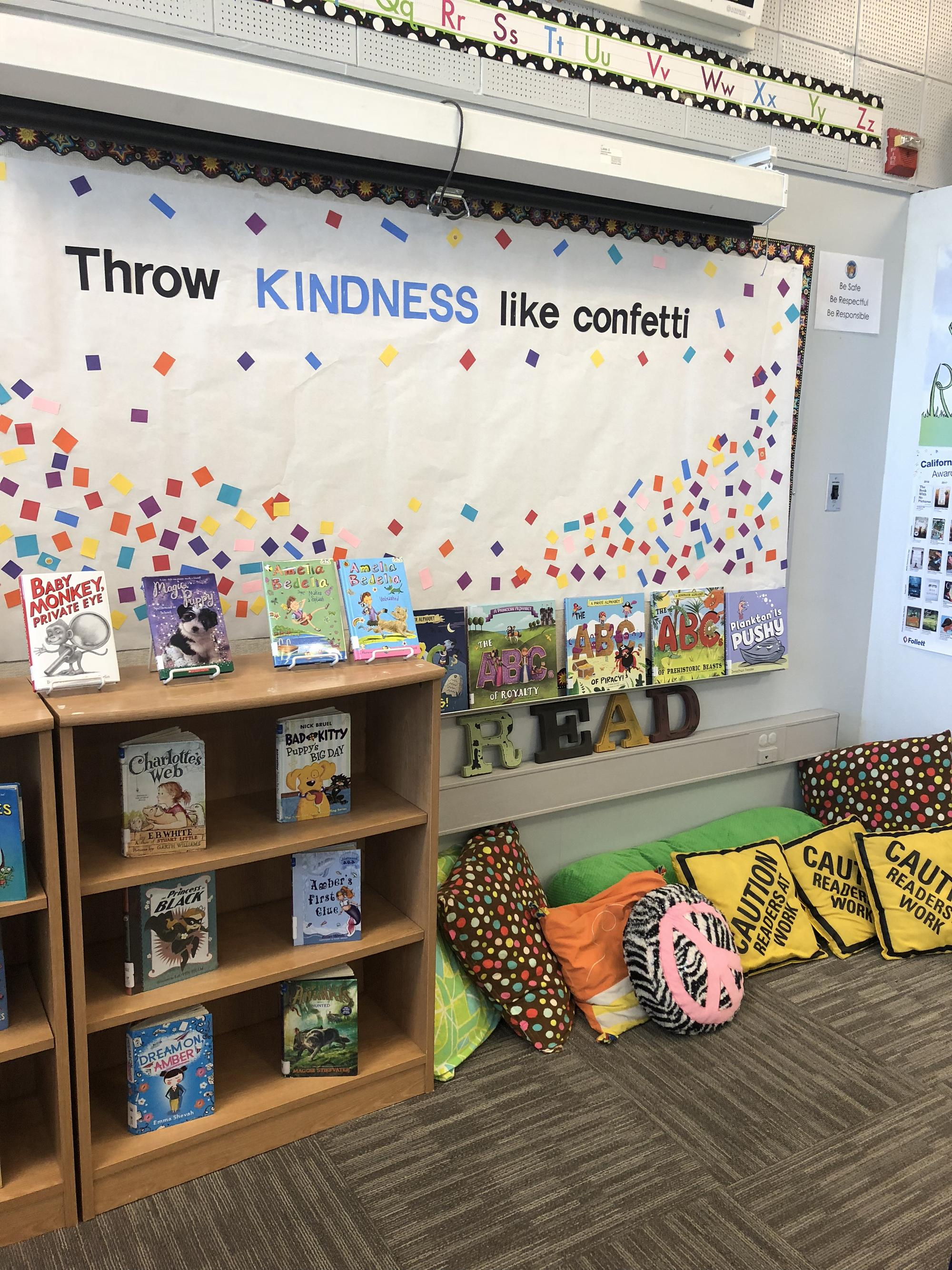 "photo of library sign that reads, ""throw kindness like confetti"""