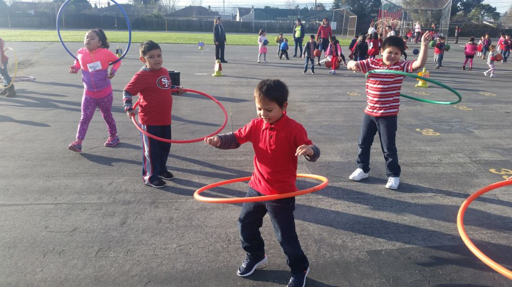 group of children with hula hoops