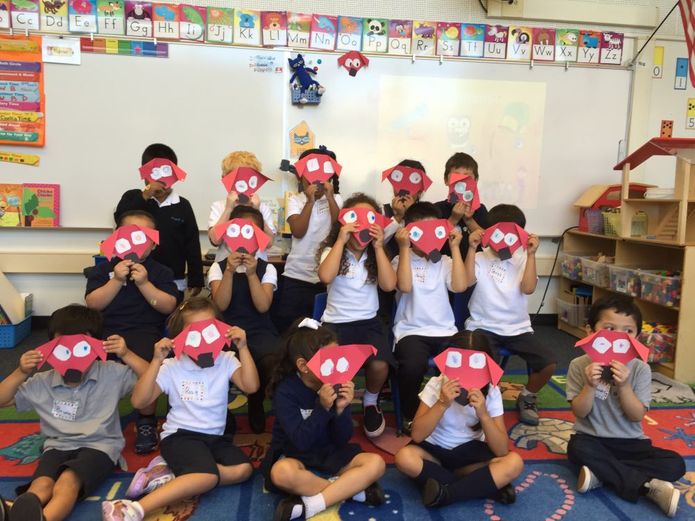 children in classroom with Clifford masks