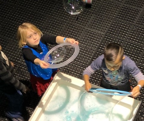first graders on a field trip to the discovery museum